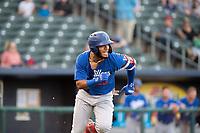 Tulsa Drillers infielder Christian Santana (23) runs for first on May 13, 2019, at Arvest Ballpark in Springdale, Arkansas. (Jason Ivester/Four Seam Images)