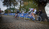 World Champion Thalita de Jong (NED/Rabo-Liv) in pursuit of defending champion Jolien Verschueren (BEL/Telenet-Fidea) up the very steep stretch of the infamous Koppenberg<br /> <br /> 25th Koppenbergcross 2016
