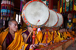 Monks  chanting with drum