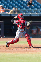 Scottsdale Scorpions catcher Mark Kolozsvary (98), of the Cincinnati Reds organization, throws to second base during an Arizona Fall League game against the Peoria Javelinas at Peoria Sports Complex on October 18, 2018 in Peoria, Arizona. Scottsdale defeated Peoria 8-0. (Zachary Lucy/Four Seam Images)