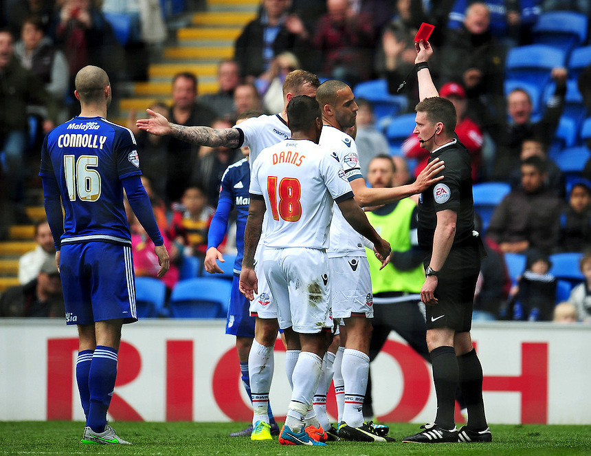 RED CARD, SENDING OFF - Bolton players protest as Niall Maher (obstructed) is shown a red card by referee Lee Collins for a foul on Cardiff City's Craig Noone (out of picture)<br /> <br /> Photographer Kevin Barnes/CameraSport<br /> <br /> Football - The Football League Sky Bet Championship - Cardiff City v Bolton Wanderers - Saturday 23rd April 2016 - Cardiff City Stadium - Cardiff <br /> <br /> &copy; CameraSport - 43 Linden Ave. Countesthorpe. Leicester. England. LE8 5PG - Tel: +44 (0) 116 277 4147 - admin@camerasport.com - www.camerasport.com