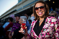 HALLANDALE BEACH, FL - JAN 28: With post-time approaching a fan samples a raspberry champagne drink during the Pegasus World Cup Invitational Day at Gulfstream Park Race Course on January 28, 2017 in Hallandale Beach, Florida. (Photo by Scott Serio/Eclipse Sportswire/Getty Images)