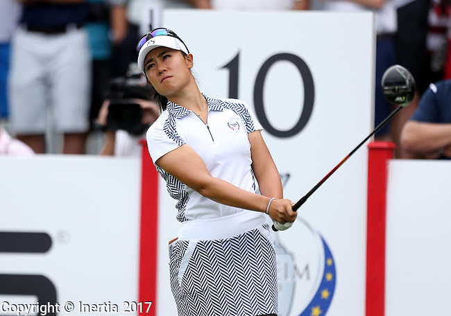 DES MOINES, IA - AUGUST 19: USA's Danielle Kang watches her tee shot on the 10th hole during Saturday morning's foursomes match at the 2017 Solheim Cup in Des Moines, IA. (Photo by Dave Eggen/Inertia)