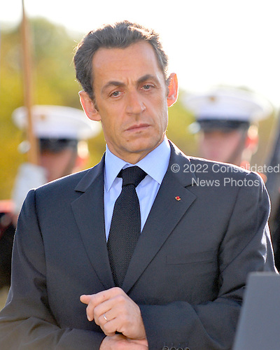 Camp David, MD - October 18, 2008 --  President Nicolas Sarkozy of France, who also serves as this year's rotating President of the European Union (EU), listens as United States President George W. Bush makes remarks on his arrival at the Presidential Retreat near Thurmont, Maryland for talks on Saturday, October 18, 2008.  The two European leaders stopped at Camp David to meet with President Bush to discuss the economy on their way home from a summit in Canada to try to convince Bush to support a summit by year's end to try to reform the world financial system..Credit: Ron Sachs / Pool via CNP