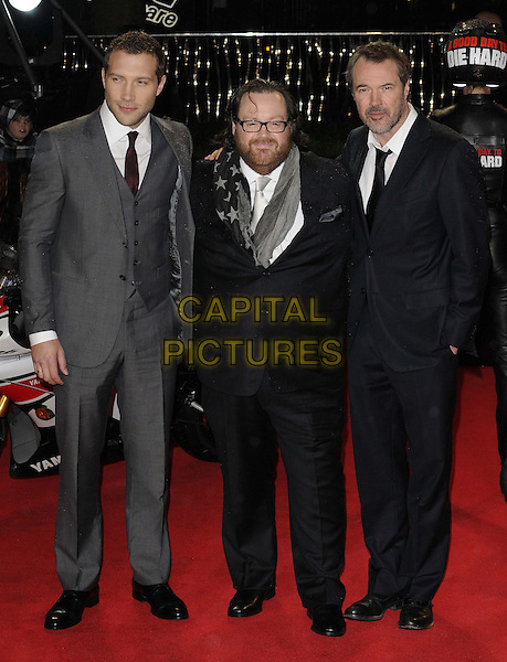 """Jai Courtney, John Moore (Director) & Sebastian Koch.The """"A Good Day To Die Hard"""" UK film premiere, Empire cinema, Leicester Square, London, England..February 7th, 2013.full length black grey gray suit glasses beard facial hair stars print .CAP/CAN.©Can Nguyen/Capital Pictures."""