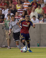 Toronto FC defender Marco Velez (4) and Real Salt Lake forward Yura Movsisyan (14) battle for the ball. Salt Lake Real defeated Toronto FC, 3-0, at Rio Tinto Stadium on June 27, 2009.