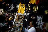 A hope keeper talks to customers in a t shirt shop that displays an image of President Barack Obama In Amhara's regional capital Bahir Dar on President Barack Obama's inauguration day, Tuesday January 20 2009..