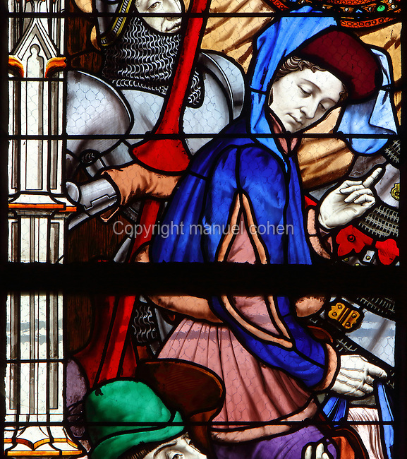Vaucouleurs window, showing St Joan of Arc leaving on horseback with Jean de Metz and the peasants, 25th February 1429, from a series of 19th century stained glass windows by Galland and Gibelin illustrating the life of Joan of Arc, in the nave of Orleans Cathedral, or the Basilique Cathedrale Sainte-Croix d'Orleans, built in Gothic style 1278-1329 and largely rebuilt 1601-1829 after it was partially destroyed in 1568, in Orleans, Loiret, Centre, France. The cathedral is listed as a historic monument. Picture by Manuel Cohen
