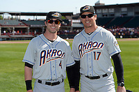 Akron RubberDucks outfielder Tyler Naquin (4) and manager Dave Wallace (17) pose for a photo after a game against the Erie SeaWolves on May 18, 2014 at Jerry Uht Park in Erie, Pennsylvania.  Akron defeated Erie 2-1.  (Mike Janes/Four Seam Images)