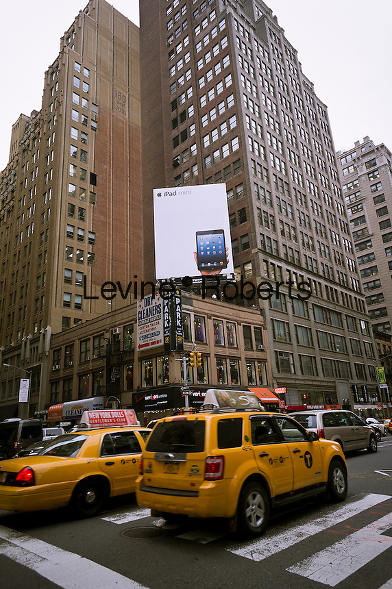 Advertising for the Apple iPad Mini on a billboard in Midtown Manhattan in New York on Friday, October 26, 2012. The new tablet is expected to be released November 3, 2012.  (© Richard B. Levine)