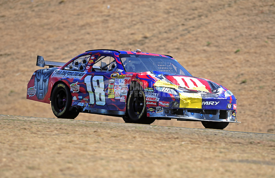 Jun. 21, 2009; Sonoma, CA, USA; NASCAR Sprint Cup Series driver Kyle Busch during the SaveMart 350 at Infineon Raceway. Mandatory Credit: Mark J. Rebilas-