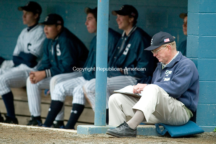 WASHINGTON DEPOT, CT- 02 MAY 2008- 050208JT09-<br /> Scorekeeper Ray Reich watches Shepaug play Lewis Mills from the dugout during Friday's game at Ted Alex Field.<br /> Josalee Thrift / Republican-American