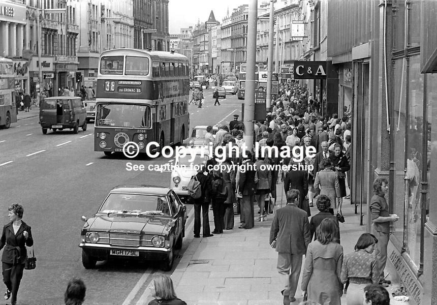 A bustling Belfast, N Ireland, gets back to work after the end of the Ulster Workers' Council strike which lasted from 15 to 28 May, 1974. 197405290298a<br /> <br /> Copyright Image from Victor Patterson, 54 Dorchester Park, <br /> Belfast, UK, BT9 6RJ<br /> <br /> t1: +44 28 9066 1296 (from Rep of Ireland 048 9066 1296)<br /> t2: +44 28 9002 2446 (from Rep of Ireland 048 9002 2446)<br /> m: +44 7802 353836<br /> <br /> e1: victorpatterson@me.com<br /> e2: victorpatterson@gmail.com<br /> www.victorpatterson.com<br /> <br /> Please see my Terms and Conditions of Use at www.victorpatterson.com. It is IMPORTANT that you familiarise yourself with them.<br /> <br /> Images used on the Internet must be visibly watermarked i.e. &copy; Victor Patterson<br /> within the body of the image and copyright metadata must not be deleted. Images <br /> used on the Internet have a size restriction of 4kbs and will be chargeable at current<br />  NUJ rates unless agreed otherwise.<br /> <br /> This image is only available for the use of the download recipient i.e. television station, newspaper, magazine, book publisher, etc, and must not be passed on to any third <br /> party. It is also downloaded on condition that each and every usage is notified within 7 days to victorpatterson@me.com<br /> <br /> The right of Victor Patterson to be identified as the author is asserted in accordance with The Copyright Designs And Patents Act (1988).