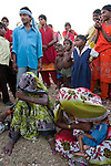 Bhagwati,(left) mother in law to 22 year old Preeti with her son Mohan Singh (in blue at rear) and their malnourished kids near  Silanagar village outside Shivpuri in Madhya Pradesh state in india. Ignoring offers of help for her malnourished child she simply turned on her heels and left knowing the elder males of the village would refuse permission for her to leave. Despite 15 yeas of economic growth the incidence of child malnutrition has barely changed -- 46 percent of children under 5 in India are malnourished: twice the rate of sub Saharan Africa.. A report released last week said a mixture of poor governance , the caste system dis-empowerment of women and superstition are preventing children from getting the nutrition they need, condemning another generation to brain damage, low earning potential and early death. At the moment 3000 children a day die in India as a result of malnutrition.