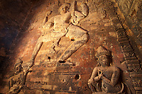 In a scence for Hindu mythology, the god Vishnu is depicted in a brick bas relief carving inside  Prasat Kravan, one of the temples of Angkor, Cambodia