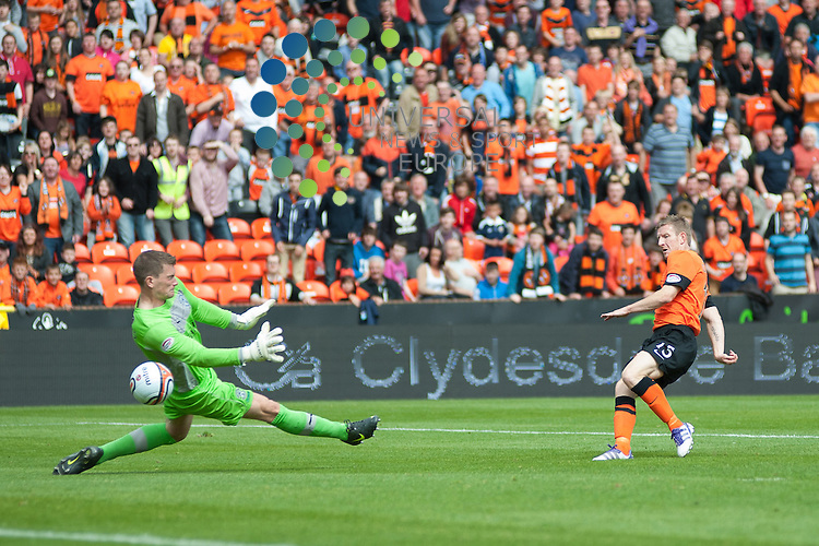 Michael Gardyne makes it 3-0 to Dundee Utd..Dundee Utd and Hibs contest their first SPL game of the 12/13 season at Tannadice in Dundee on Sunday 5th August. Universal News and Sport (Scotland)