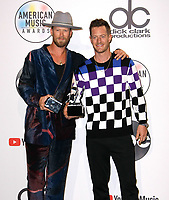 LOS ANGELES, CA - OCTOBER 09: Brian Kelley and Tyler Hubbard of Florida Georgia Line pose in the press room during the 2018 American Music Awards at Microsoft Theater on October 9, 2018 in Los Angeles, California. <br /> CAP/MPI/IS<br /> &copy;IS/MPI/Capital Pictures