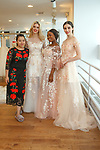 Left to right fashion designer Chelsea Liu, model Shannon Mcnulty, Chief Operating Officer Abby Awokere and model Lilit pose together at the close of the Chelsea Liu bridal fashion presentation in LEEZ department store, at 37 Trinity Place in New York City on October 7, 2017; during New York Bridal Fashion Week Spring 2018.