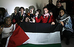 Members of Italian activists delegation pose for a photograph upon their arrival at the Rafah crossing between Gaza Strip and Egypt, January 02, 2014.  The delegation is expected to stay two days to show their support and solidarity with the Gazans. Photo by Eyad Al Baba
