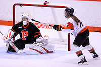Princeton's goaltender Kimberly Newell and RIT's Tenecia Hiller (6) watch the rebound puck flying during the 3rd period. Princeton defeated RIT 2-1 at Ritter Arena in Rochester, New York on October 19, 2012