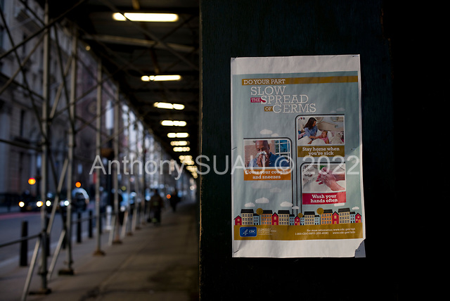 New York, New York<br /> March 18, 2020<br /> 9:15 AM<br /> <br /> Manhattan under coronavirus pandemic. <br /> <br /> Health warning posted on the street near the NYSE. <br /> <br /> The New York Stock Exchange and Wall Street void of people as the market falls over 10,000 points following weeks of the economic fear as a result of the virus.