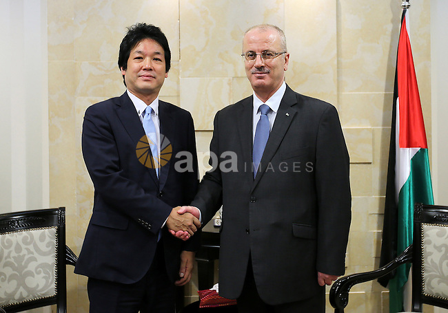 Palestinian Prime Minister Rami Hamdallah meets with Japanese Vice Foreign Minister Kentaro Sonoura, in the West Bank city of Ramallah, on Sep. 06, 2016. Photo by Prime Minister Office