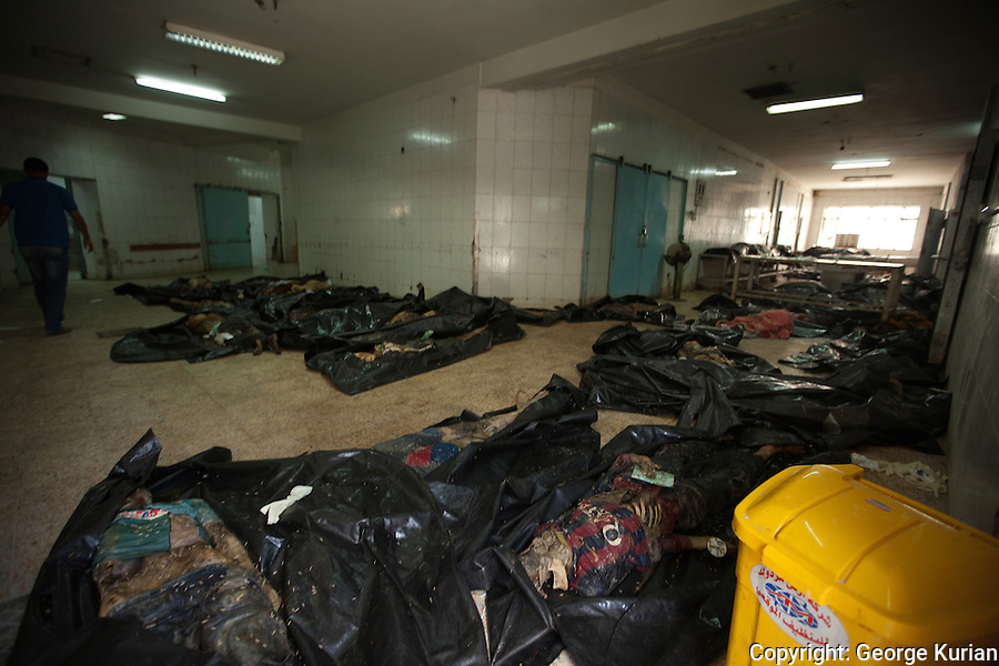 The military brought in 35 bodies to the Baghdad morgue two days ago. All the bodies are of soldiers from Tikrit. The forensic consultant at the morgue said they had all been shot at close range.<br /> According to the forensic consultant, they were all killed between 5 and 10 days ago but exposure to the summer heat has led to the severe state of decomposition.<br /> Many of the bodies were in civilian clothes, leading the forensic team to conclude that they were caught unawares and executed.