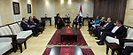 Palestinian Prime Minister, Rami Hamdallah, meets with a delegation of Christian clergy, in the West Bank city of Ramallah, on May 23, 2018. Photo by Prime Minister Office