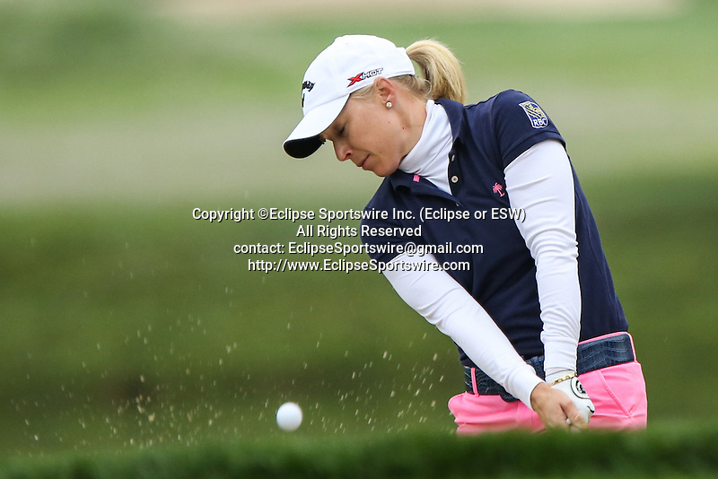 American Morgan Pressel hits her ball out of the bunker and onto the first hole at the LPGA Championship at Locust Hill Country Club in Pittsford, NY on June 7, 2013