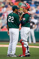 Starting pitcher Felix Doubront (22) and catcher Luis Exposito (23) have a talk on the mound at Fluor Field in Greenville, SC, Sunday, April 6, 2008.