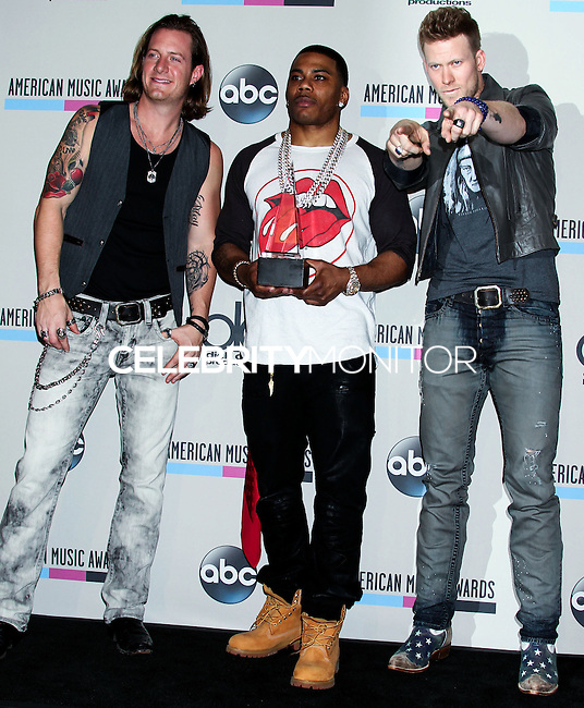 LOS ANGELES, CA - NOVEMBER 24: Nelly, Tyler Hubbard, Brian Kelly in the press room at the 2013 American Music Awards held at Nokia Theatre L.A. Live on November 24, 2013 in Los Angeles, California. (Photo by Celebrity Monitor)