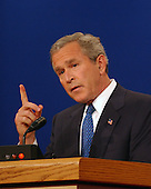 Coral Gables, FL - September 30, 2004 -- United States President George W. Bush makes a point by holing up one finger as he debates his Democratic challenger United States Senator John F. Kerry (Democrat of Massachusetts) in the first of their three scheduled meetings at the University of Miami in Coral Gables, Florida on September 30, 2004..Credit: Ron Sachs / CNP