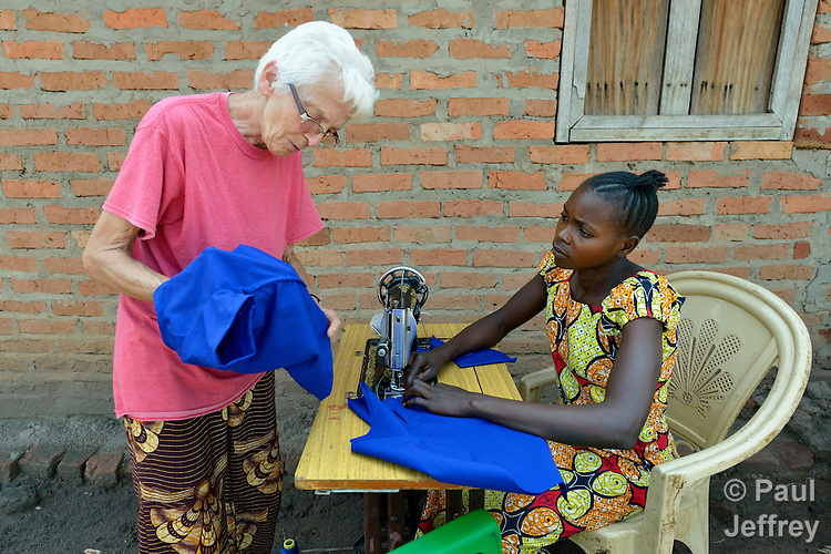 Sister Celine Tremblay, a Canadian member of the Daughters of Providence, discusses a sewing project with a woman in the Makpandu refugee camp, a ramshackle collection of huts with mud walls and thatched roofs spread through a remote section of forest 40 kilometers from Yambio, the capital of Western Equatoria State in South Sudan. As many as 3,000 people live in the camp, having fled the Democratic Republic of the Congo in 2008 when the Lord's Resistance Army started a murderous rampage through the area. Sister Tremblay works in the camp as a member of Solidarity with South Sudan, a pastoral and teaching presence of Catholic priests, sisters and brothers from around the world.