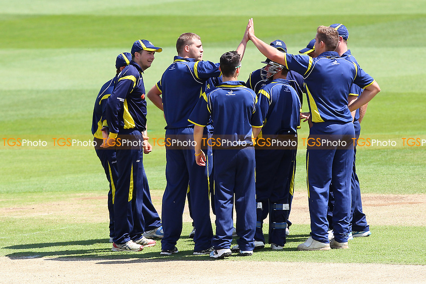 Unicorns players celebrate the wicket of Greg Smith - Essex CCC 2nd XI vs Unicorns 2nd XI - 2nd XI T20 Cricket at the Essex County Ground, Chelmsford - 14/05/14 - MANDATORY CREDIT: Gavin Ellis/TGSPHOTO - Self billing applies where appropriate - 0845 094 6026 - contact@tgsphoto.co.uk - NO UNPAID USE