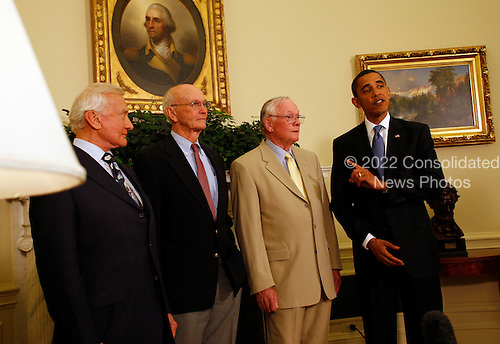 "Washington, DC - July 20, 2009 -- United States President Barack Obama meets with Apollo 11 crew members (l-r) Edwin Eugene ""Buzz"" Aldrin, Jr., Michael Collins, and Neil Armstrong in the Oval Office of the White House on the 40th anniversary of the astronauts' lunar landing, Washington, DC, Monday, July 20, 2009. .Credit: Martin H. Simon / Pool via CNP"