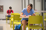 Summer school student Lauren Collins studies human A&P while waiting on her class.  Photo by Kevin Bain/Ole Miss Communications