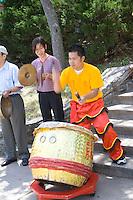 Asian American drummer and symbol percussionist age 22. Dragon Festival Lake Phalen Park St Paul Minnesota USA