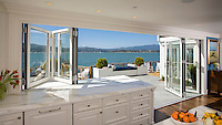 Open air kitchen to patio on San Francisco Bay with sliding glass doors and windows