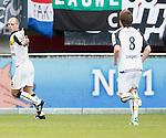 Nederland, Nijmegen, 2 december 2012.Eredivisie .Seizoen 2012-2013.N.E.C.-NAC Breda.Anthony Lurling (l.) van NAC Breda juicht nadat hij de 0-1 heeft gescoord. Rechts Thilo Leugers van NAC Breda