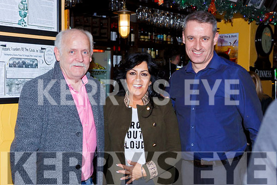 Denis and Marie Carroll and Edward O'Donoghue seeing in the New Year in the Porterhouse bar Killarney