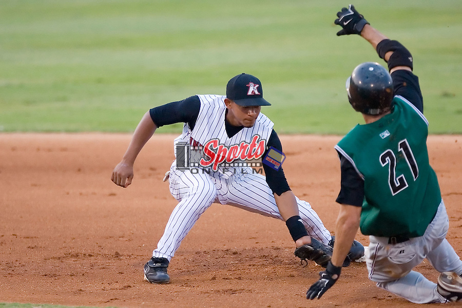 Second baseman Eduardo Escobar (6) of the Kannapolis Intimidators applies the tag to Nick Noonan (21) of the Augusta GreenJackets at Fieldcrest Cannon Stadium in Kannapolis, NC, Wednesday August 20, 2008. (Photo by Brian Westerholt / Four Seam Images)