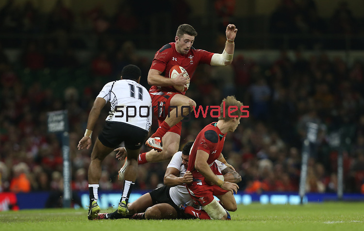 Wales wing Alex Cuthbert leaps in to take the pass from Liam Williams.<br /> Dove Men Series 2014<br /> Wales v Fiji<br /> Millennium Stadium<br /> 15.11.14<br /> ©Steve Pope-SPORTINGWALES