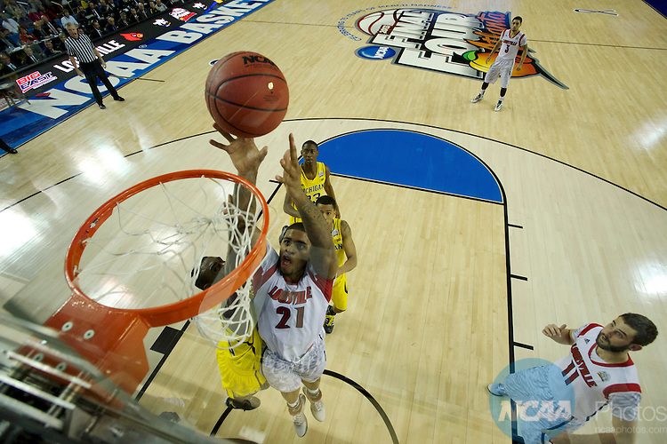 8 APR 2013: Chane Behanan (21) of the University of Louisville goes for a shot over Tim Hardaway Jr. (10) University of Michigan during the 2013 NCAA Men's DI Basketball Championship Final Four held at the Georgia Dome in Atlanta, GA. ©Chris Steppig/NCAA Photos