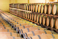 Oak barrel aging and fermentation cellar. Chateau de Haux, Bordeaux, France