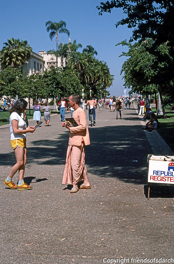 San Diego: Balboa Park--Krishna distributing literature.  (Photo 1984)