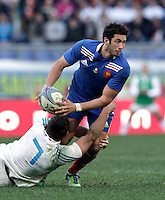 Rugby, torneo Sei Nazioni 2013: Italia vs Francia. Roma, stadio Olimpico, 3 febbraio 2013..France's Maxime Mermoz is tackled by Italy's Simone Favaro, left, during the Six Nations rugby union international match between Italy and France, at Rome's Olympic stadium, 3 February 2013..UPDATE IMAGES PRESS/Riccardo De Luca