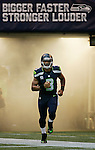 Seattle Seahawks quarterback Russell Wilson runs onto the field during introductions before their game with the San Francisco 49ers  at CenturyLink Field in Seattle, Washington on September 15, 2013. The Seahawks beat the 49ers 29-3. ©2013. Jim Bryant Photo. ALL RIGHTS RESERVED.