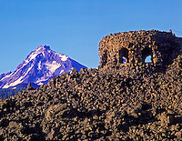 Dee Wright Observatory and South Sister Mountain. McKenzie Pass, Oregon