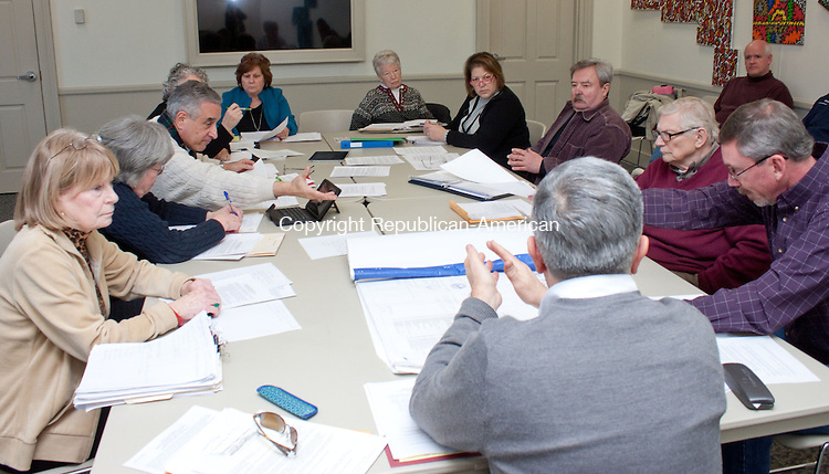 WATERBURY CT- JANUARY 29 2014 012914DA10- Members of a new taskforce on use of the library basement from left, Shirley Michaels, John Monteleone, Donna Pereira, Ginger Salisbury, Ginny Middleton, Chris Tolley, Edgar Mills, Sherman London, Mark Cody, and Barry Rickert met for the first time Wednesday to discuss whether the basement can be used for a book sale for the Friends of the Southbury Public Library, or whether insurance regulations will prevent that.<br /> Darlene Douty Republican American