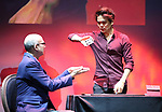 """Journalist Richard Ridge with Shin Lim, """"The Manipulator"""" from the cast of Broadway's """"The Illusionists—Magic of the Holidays"""" on stage for a press preview at the Marquis Theatre  on November 27, 2018 in New York City."""